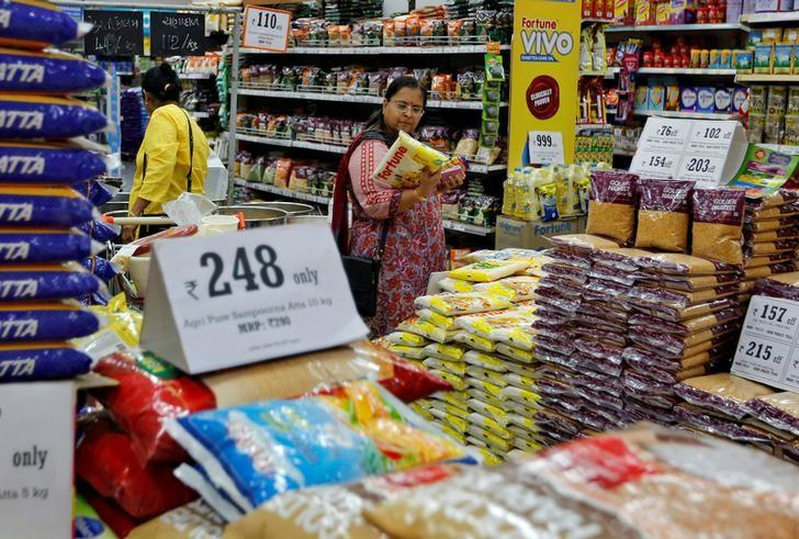 A woman looks at an item as she shops at a food superstore in Ahmedabad, India October 13, 2016. REUTERS/Amit Dave/File Photo