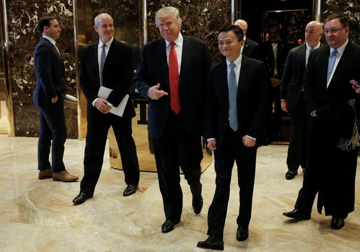 U.S. President-elect Donald Trump walks from an elevator with Alibaba executive chairman Jack Ma after their meeting at Trump Tower in New York, U.S., January 9, 2017. REUTERS/Mike Segar