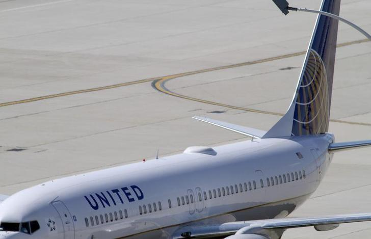 A United Airlines plane with the Continental Airlines logo on its tail, sits at a gate at O'Hare International airport in Chicago October 1, 2010. REUTERS/Frank Polich