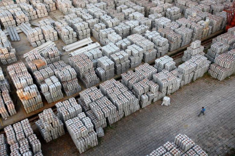 A worker walks through an aluminium ingots depot in Wuxi, Jiangsu province September 26, 2012.  REUTERS/Aly Song/File Photo