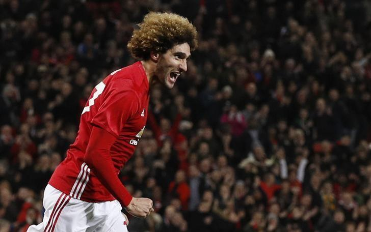 Britain Football Soccer - Manchester United v Hull City - EFL Cup Semi Final First Leg - Old Trafford - 10/1/17 Manchester United's Marouane Fellaini celebrates scoring their second goal  Reuters / Phil Noble Livepic