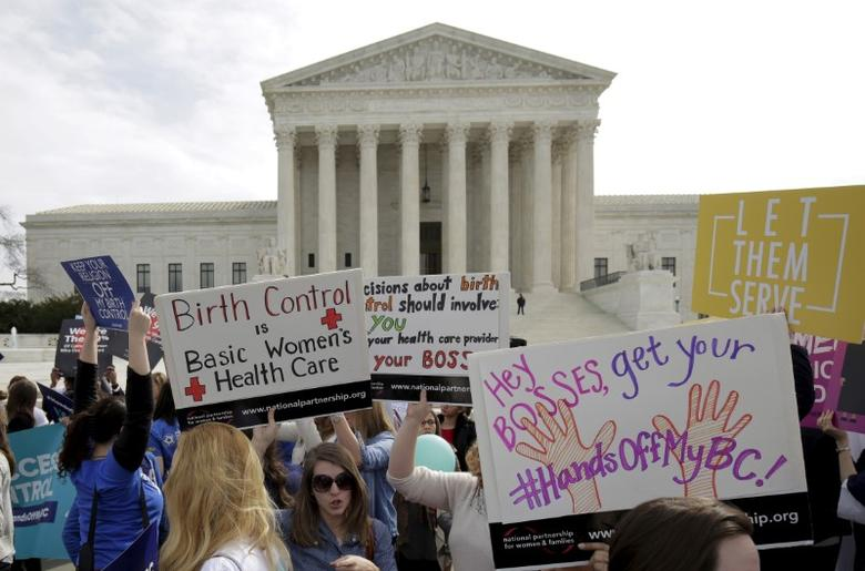 FILE PHOTO - Supporters of contraception rally before Zubik v. Burwell, an appeal brought by Christian groups demanding full exemption from the requirement to provide insurance covering contraception under the Affordable Care Act, is heard by the U.S. Supreme Court in Washington, DC, U.S. on March 23, 2016. REUTERS/Joshua Roberts/File Photo