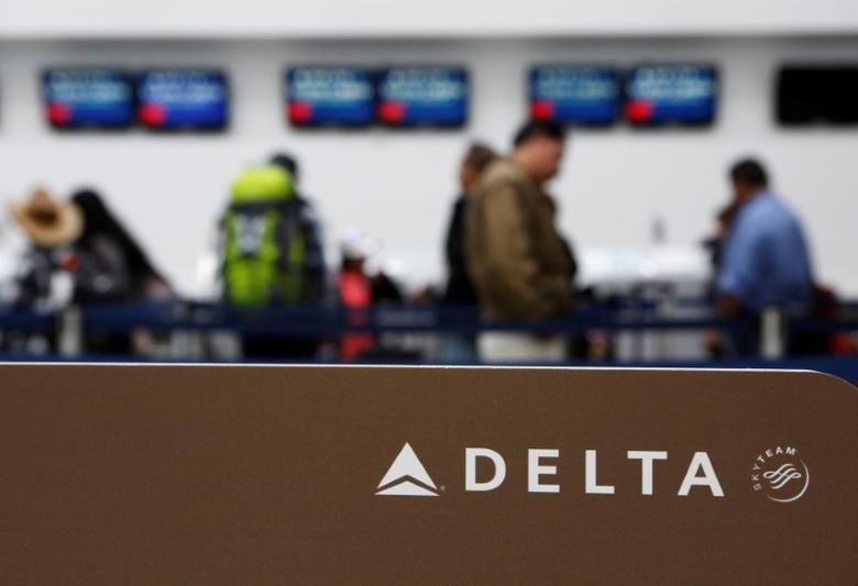 Passengers check in at a counter of Delta Air Lines in Mexico City, Mexico, August 8, 2016. REUTERS/Ginnette Riquelme/File Photo