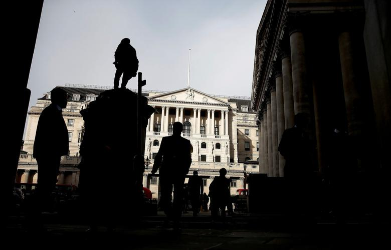 FILE PHOTO: Pedestrians are silhouetted as the winter sun shines on to front of the Bank of England in the City of London, Britain, November 3, 2016. REUTERS/Peter Nicholls/File Photo
