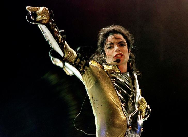 FILE PHOTO: U.S. popstar Michael Jackson performs during his ''HIStory World Tour'' concert in Vienna, July 2, 1997. REUTERS/Leonhard Foeger/File Photo