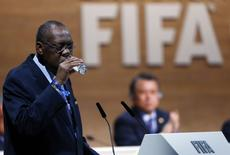FILE PHOTO - Then acting FIFA president Issa Hayatou drinks from a glass during the Extraordinary FIFA Congress in Zurich, Switzerland February 26, 2016. REUTERS/Arnd Wiegmann
