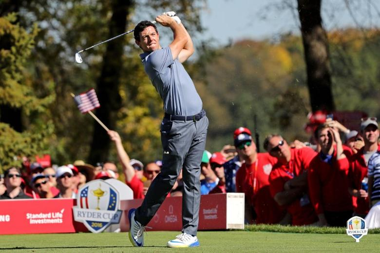 Rory McIlroy of Northern Ireland plays his shot from the seventh tee during the single matches in 41st Ryder Cup at Hazeltine National Golf Club. Mandatory Credit: Rob Schumacher-USA TODAY Sports  / Reuters