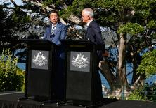 Japanese Prime Minister Shinzo Abe speaks during a media conference as Australian Prime Minister Malcolm Turnbull listens on after their bilateral meeting at Kirribilli House in Sydney, Australia, January 14, 2017.     REUTERS/Chris Pavlich