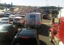 Trucks and passenger vehicles cross paths at the Canada-U.S. border crossing in Buffalo, New York, U.S. on April 6, 2012. REUTERS/Hyungwon Kang