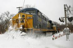 A CSX freight train blasts through high snow at a crossing in Silver Spring, Maryland, in a February 13, 2014 file photo.   REUTERS/Gary Cameron/Files