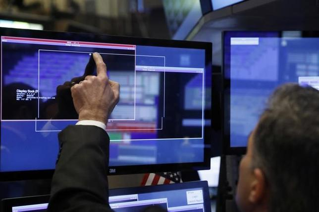 A trader works on the floor of the New York Stock Exchange (NYSE) shortly after the opening bell in New York, U.S., January 13, 2017. REUTERS/Lucas Jackson