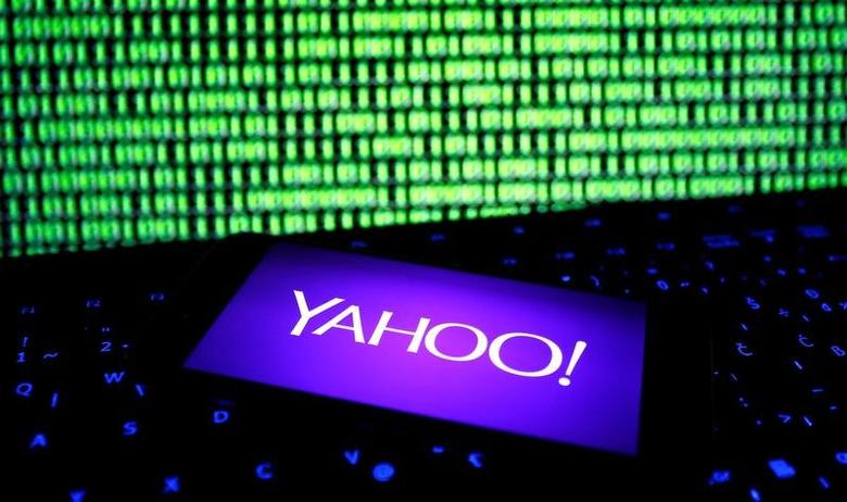 A photo illustration shows a Yahoo logo on a smartphone in front of a displayed cyber code and keyboard on December 15, 2016. REUTERS/Dado Ruvic/File Illustration