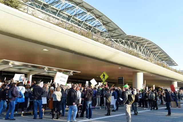 Demonstrators shout slogans during anti-Donald Trump immigration ban protests outside Terminal 4 at San Francisco International Airport in San Francisco, California, U.S., January 28, 2017. REUTERS/Kate Munsch