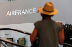 A passenger walks past an Air France logo at the Marseille-Provence airport in Marignane on the first day of a strike by Air France stewards, France, July 27, 2016.  REUTERS/Philippe Laurenson/File Photo