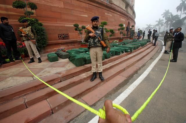 Armed policemen stand guard next to bags containing budget papers inside the parliament premises in New Delhi, India, February 1, 2017. REUTERS/Adnan Abidi