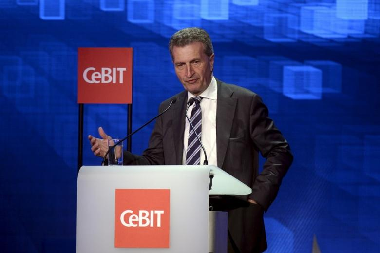 Guenther Oettinger, European Commissioner for Digital Economy and Society, speaks during the welcome night at the world's biggest computer and software fair CeBit in Hanover, Germany, March 14, 2016. REUTERS/Nigel Treblin