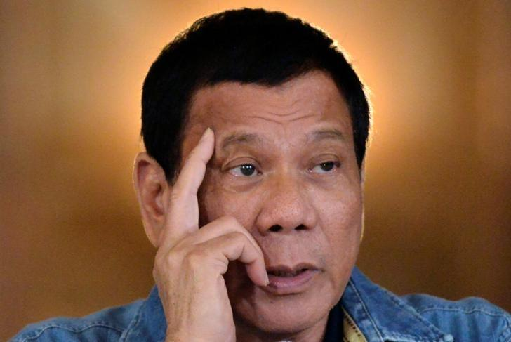 Philippine President Rodrigo Duterte speaks during a late night news conference at the presidential palace in Manila, Philippines January 29, 2017. REUTERS/Ezra Acayan