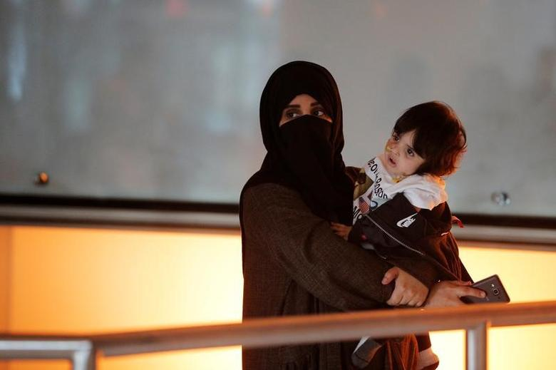 A woman and her daughter wait for two of her other children and her sister to arrive on a flight from Qatar after U.S. President Donald Trump's executive order travel ban at Logan Airport in Boston, Massachusetts, U.S. January 30, 2017.   REUTERS/Brian Snyder
