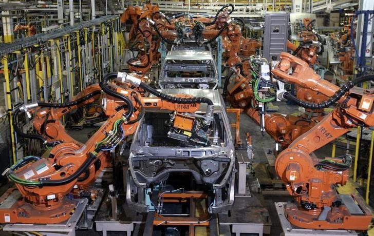 File photo: Auto assembly line robots weld on the frame of  2009 Dodge Ram pick-up trucks at the Warren Truck Assembly Plant in Warren, Michigan September 12, 2008.    REUTERS/Rebecca Cook