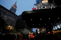 FILE PHOTO: People line up at the entrance of Macy's Herald Square ahead of early opening for Black Friday sales in Manhattan, New York, U.S., November 24, 2016.  REUTERS/Andrew Kelly/File Photo