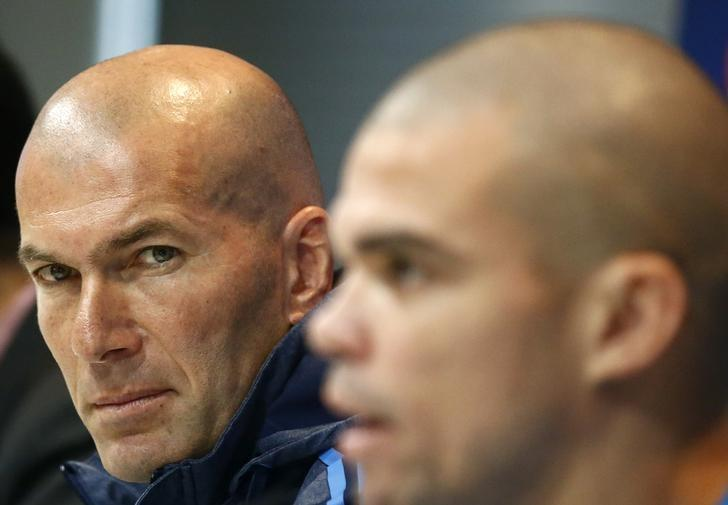 Real Madrid's coach Zinedine Zidane (L) and player Pepe attend a news conference prior to their Champions League soccer match against AS Roma in Madrid, Spain, March 7, 2016. REUTERS/Andrea Comas/File Photo