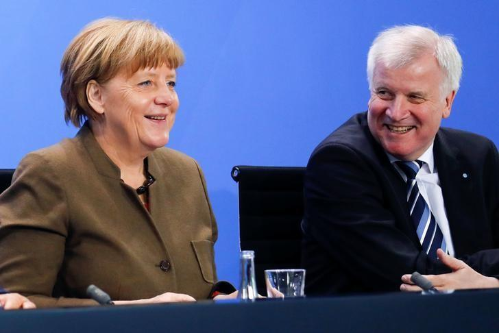 German Chancellor Angela Merkel smiles next Bavarian state premier and leader of the Christian Social Union (CSU) Horst Seehofer (R) during a news conference at the Chancellery in Berlin, Germany, April 14, 2016.   REUTERS/Fabrizio Bensch/File Photo