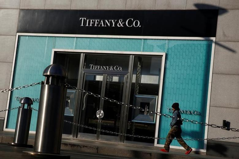 A man walks past a boutique of the luxury jewelry retailer Tiffany & Co. in Beijing, China, December 1, 2016. Picture taken December 1, 2016. REUTERS/Thomas Peter - RTSUJMS