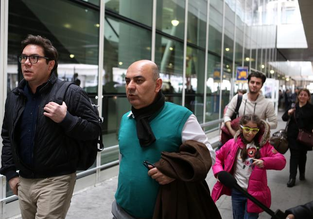 Fuad Sharef Suleman (C) and his wife and children arrive at Terminal 1 at JFK airport in Queens, New York City, New York, U.S. February 5, 2017. The Iraqi family were previously prevented from boarding a plane to the U.S. following U.S. President Donald Trump's decision to temporarily bar travelers from seven countries, including Iraq.  REUTERS/Joe Penney
