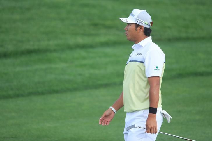 Feb 5, 2017; Scottsdale, AZ, USA; Hideki Matsuyama walks to the green of the 18th during the final round of the Waste Management Phoenix Open golf tournament  at TPC Scottsdale. Mandatory Credit: Allan Henry-USA TODAY Sports