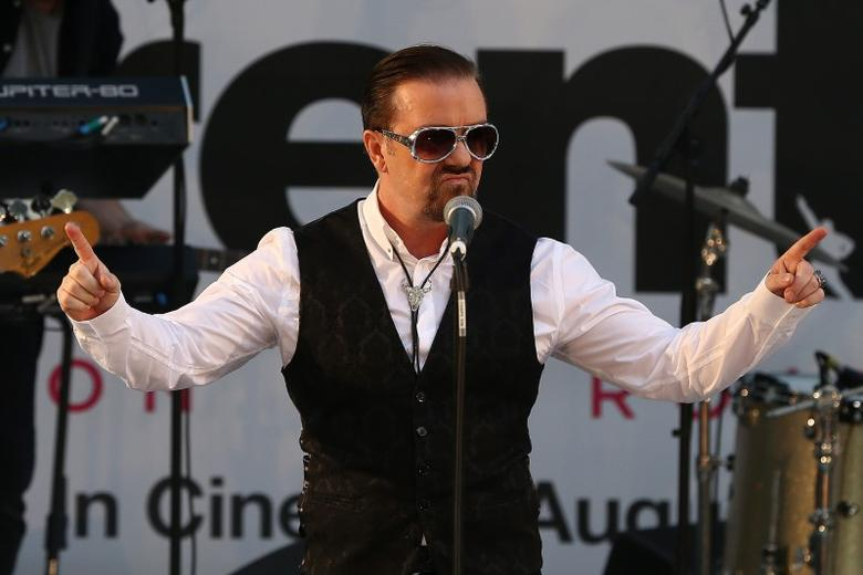 Actor and director Ricky Gervais performs as his character David Brent at the world premiere of his film David Brent Life on the Road in London, Britain August 10, 2016. REUTERS/Neil Hall/Files