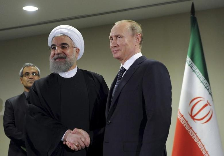 Russia's President Vladimir Putin (R) meets with Iran's President Hassan Rouhani on the sidelines of the United Nations General Assembly in New York, September 28, 2015.Mikhail Klimentyev/RIA Novosti/Kremlin/File Photo via REUTERS