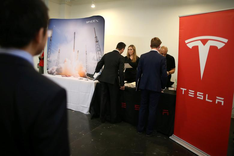 People attend the Tesla and Space X booth at TechFair LA, a technology job fair, in Los Angeles, California, U.S., January 26, 2017. REUTERS/Lucy Nicholson