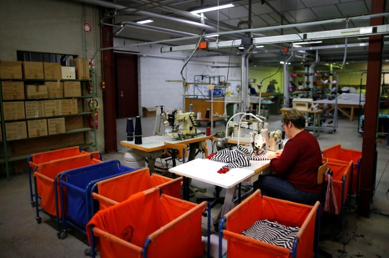 An employee uses a sewing machine as she works at the Royal Mer Bretagne factory, specializing in French manufactured knitted clothes, in La Regrippiere, western France, November 28, 2016. REUTERS/Stephane Mahe