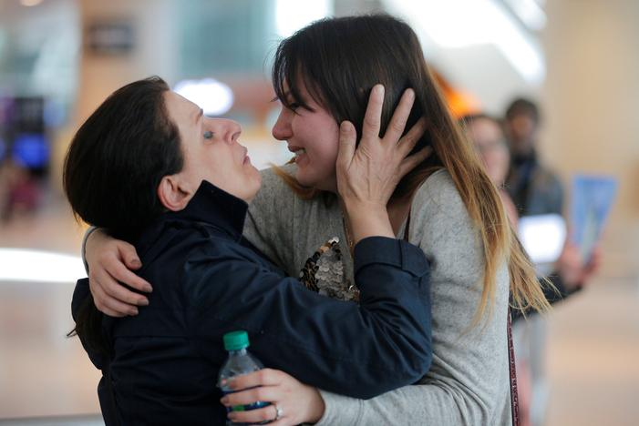 Shanez Tabarsi (L) is greeted by her daughter Negin after traveling to the U.S. from Iran following a federal court's temporary stay of U.S. President Donald Trump's executive order travel ban at Logan Airport in Boston, Massachusetts, U.S. February 6, 2017.