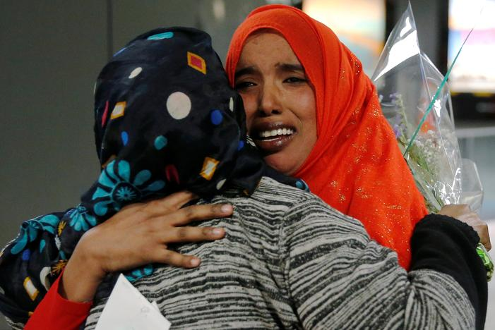 Najmia Abdishakur (R), a Somali national who was delayed entry to the U.S. because of the recent travel ban, is greeted by her mother Zahra Warsma (L) at Washington Dulles International Airport in Chantilly, Virginia, U.S. February 6, 2017.