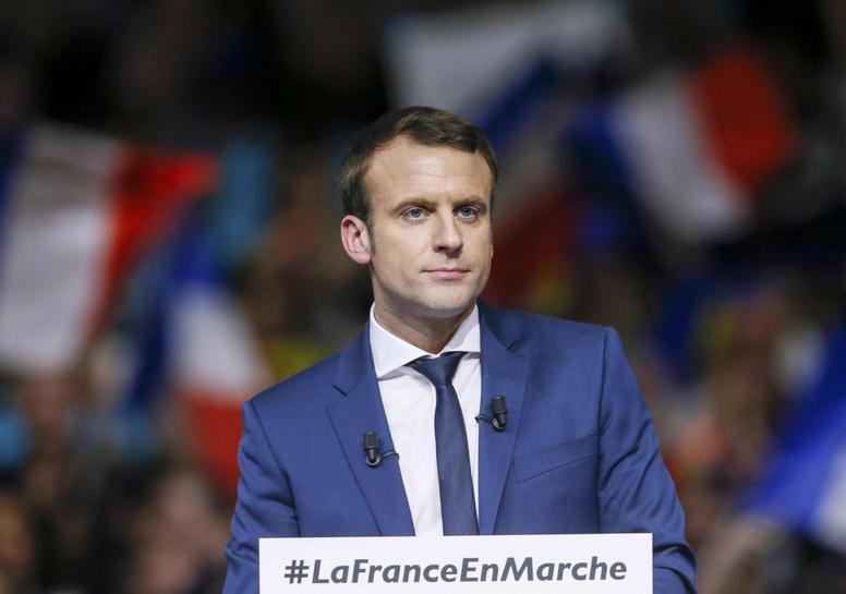 France's Macron dismisses affair as rival Fillon battles scandal