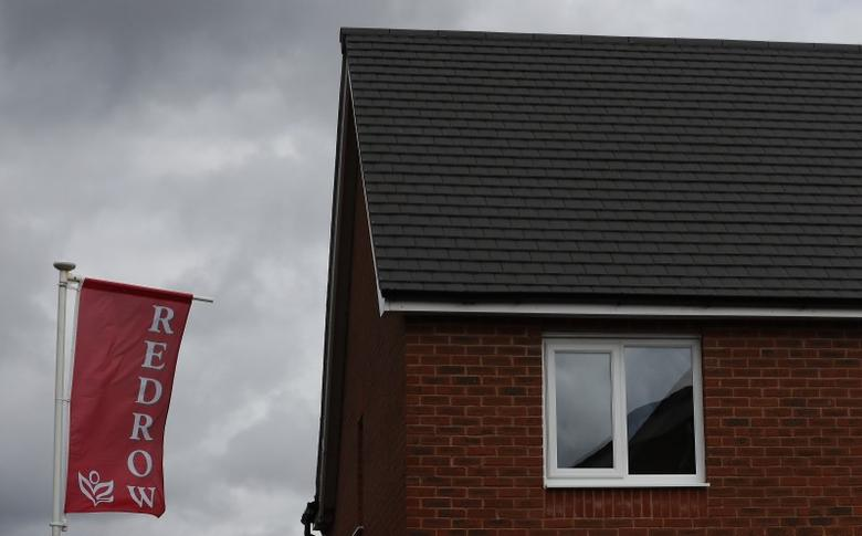 The company logo of construction company Redrow is pictured on a flag at a new housing development near Manchester northern England, April 7, 2016. REUTERS/Phil Noble