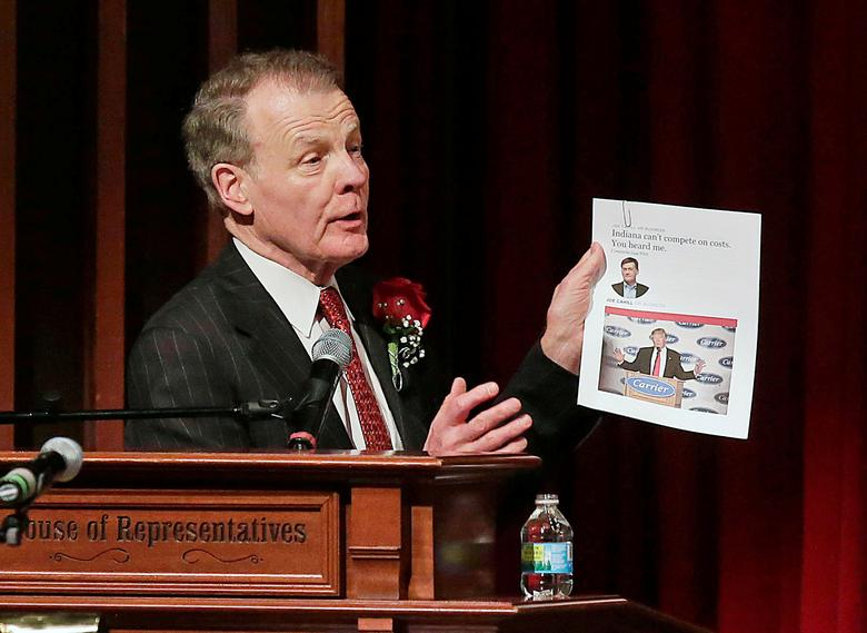 Illinois State Representative Michael Madigan holds up a photo of President-Elect Donald Trump as he addresses state representatives  after he was re-elected as Speaker of the House at the University of Illinois campus in Springfield, Illinois, U.S., January 11, 2017. REUTERS/Joshua Lott