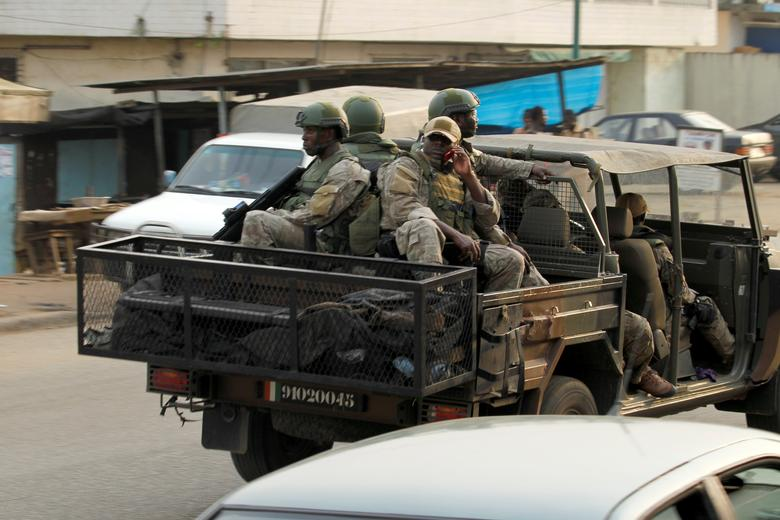 Soldiers of Ivorian special forces drive through the city of Adiake, Eastern Ivory Coast  February 7,2017. REUTERS/Luc Gnago