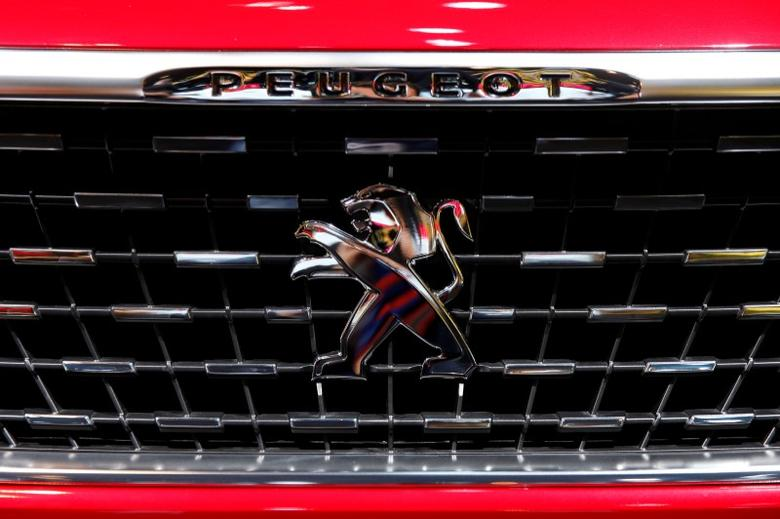 A Peugeot car logo is seen on media day at the Paris auto show, in Paris, France, September 29, 2016. REUTERS/Benoit Tessier/File Photo