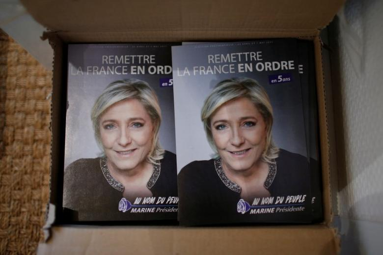 Campaign leaflets for France's far-right National Front (FN) leader Marine Le Pen, candidate in the French 2017 presidential elections, is seen at the National Front local offices in Luce near Chartres, France, February 2, 2017. REUTERS/Stephane Mahe