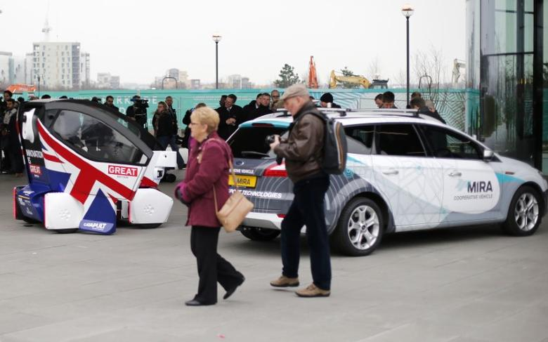 People view prototypes of a driverless vehicles in Greenwich, east London, February 11, 2015. REUTERS/Suzanne Plunkett/File Photo