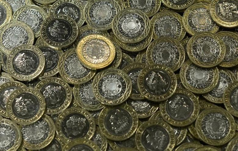 New two pound coins are seen at The Royal Mint, in Llantrisant, Wales, Britain, January 25, 2017. Picture taken January 25, 2017. REUTERS/Rebecca Naden