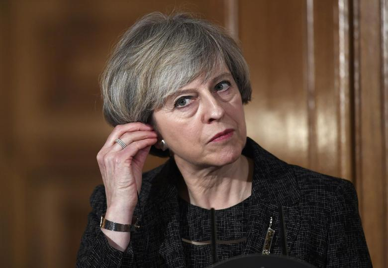 Britain's Prime Minister Theresa May holds a press conference with her counterpart from Italy  Paolo Gentiloni (not shown) at Number 10 Downing Street in London, February 9, 2017. REUTERS/Toby Melville