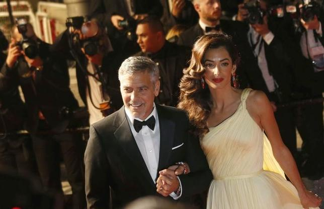 Cast member George Clooney and his wife Amal leave the Festival Palace after the screening of the film ''Money Monster'' out of competition at the 69th Cannes Film Festival in Cannes, France, May 12, 2016. REUTERS/Regis Duvignau