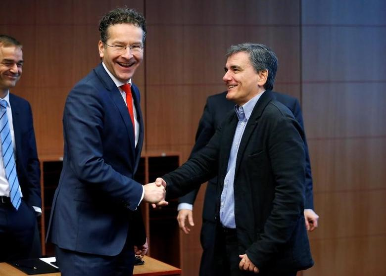 Dutch Finance Minister and Eurogroup President Jeroen Dijsselbloem greets Greek Finance Minister Euclid Tsakalotos (R) during a euro zone finance ministers meeting in Brussels, Belgium December 5, 2016. REUTERS/Francois Lenoir