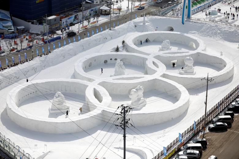 An ice sculpture of the Olympic rings is seen during the Pyeongchang Winter Festival, near the venue for the opening and closing ceremony of the PyeongChang 2018 Winter Olympic Games in Pyeongchang, South Korea, February 10, 2017.  REUTERS/Kim Hong-Ji/Files