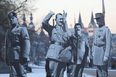 """FILE PHOTO:Activists placed life-size cardboards, depicting Benito Mussolini, Adolf Hitler, Josef Stalin and Philippe Petain in front of the Kaiser Wilhelm monument at the Deutsches Eck (""""German Corner"""") to protest against a European far-right leaders meeting, in Koblenz, Germany, January 21, 2017.      REUTERS/Kai Pfaffenbach/File Photo"""