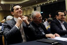 Greek Prime Minister Alexis Tsipras adjusts his shirt collar as he sits next to Deputy Prime Minister Giannis Dragasakis (C) and Digital Policy Minister Nikos Pappas before his speech at the ruling Syriza party central committee in Athens, Greece February 11, 2017. REUTERS/Michalis Karagiannis
