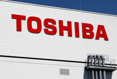 FILE PHOTO -  The logo of Toshiba is pictured on its flash memory factory, seen during a media tour in Yokkaichi, western Japan September 9, 2014.  REUTERS/Reiji Murai/File Photo